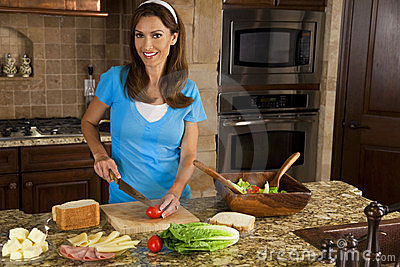 Attractive Woman Making Sandwiches In Home Kitch