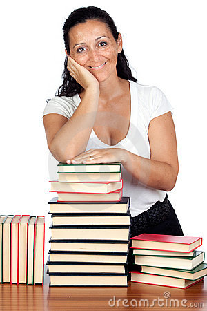 Attractive woman with many books