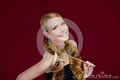 Attractive woman with masquerade mask and tinsel