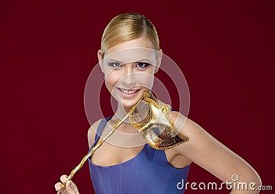 Attractive woman with masquerade masque
