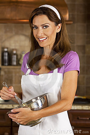 Attractive Woman Mixing & Baking In Kitchen