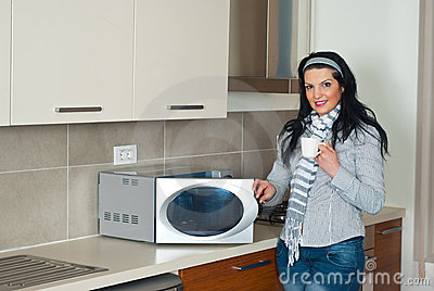 Attractive woman in modern kitchen