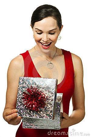 Attractive woman opening gift box