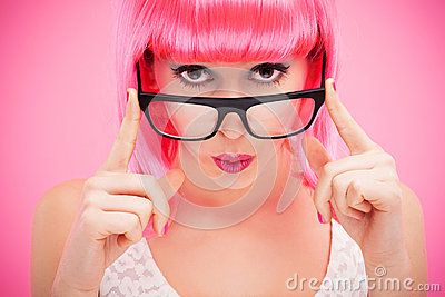Attractive woman peeking over glasses