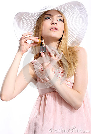 Attractive woman with perfume bottle