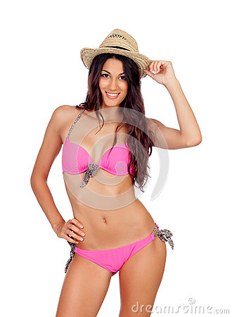 Attractive woman with pink swimwear and straw hat