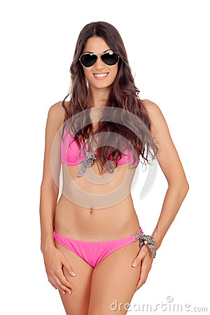 Attractive woman with pink swimwear and sunglasses