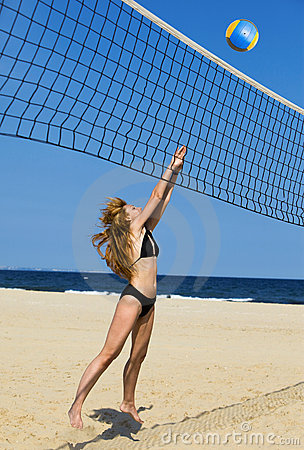 Attractive woman plays in volleyball