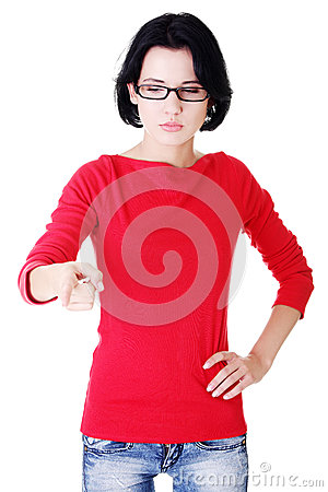 Attractive woman pointing down with eyeglasses.