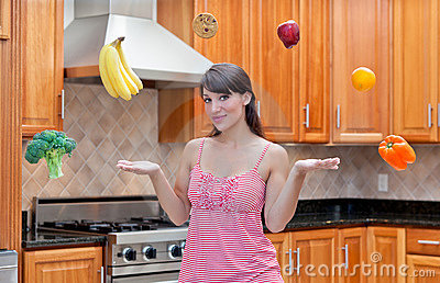 Attractive woman pondering diet and nutrition