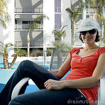 Attractive woman by pool