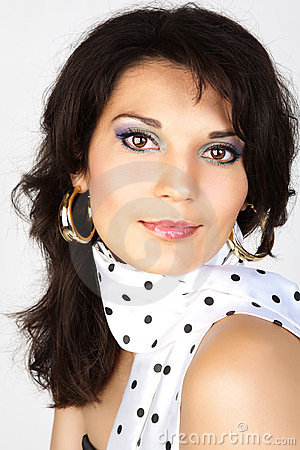 Attractive woman portrait in a white scarf.