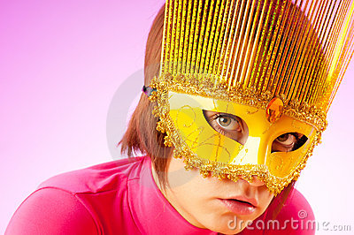 Attractive woman posing in the  mask