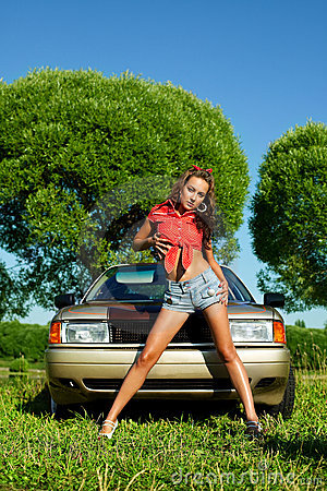 Attractive woman ready for washing a car
