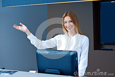 Attractive woman receptionist making friendly gesture