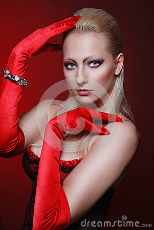 Attractive woman in a red gloves