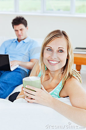 Attractive woman relaxing with a cup of coffee