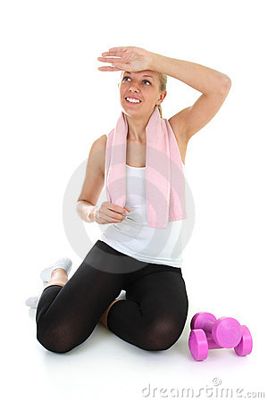 Attractive woman relaxing after gymnastics