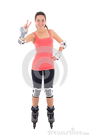 Attractive woman in roller skates posing isolated on white backg