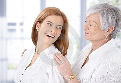 Attractive woman and senior mother laughing