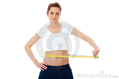 Attractive woman shows her old huge jeand, diet