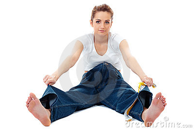 Attractive woman shows her old huge jeans, diet