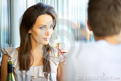 Attractive Woman Sipping Wine
