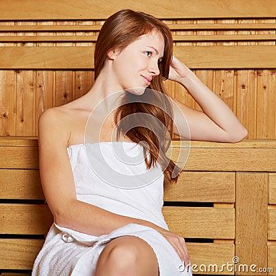 Attractive woman sitting in sauna