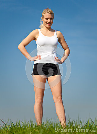 Attractive woman in sports wear outside
