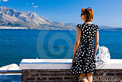 Attractive woman standing on the Gaeta sea coast