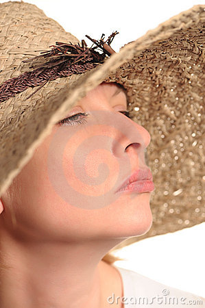 Attractive woman and straw hat