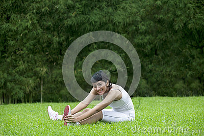 Attractive woman stretching outdoor