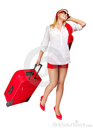 Attractive woman  with suitcase talking phone