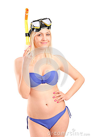 Attractive woman in swimsuit with snorkeling mask