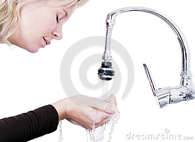 Attractive woman takes water from the palm of your hand.