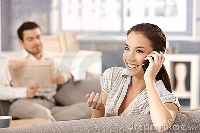 Attractive woman talking on phone smiling