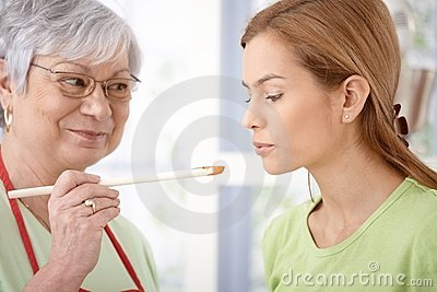 Attractive woman tasting food while cooking