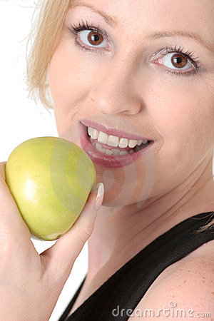 Attractive woman about to eat an apple