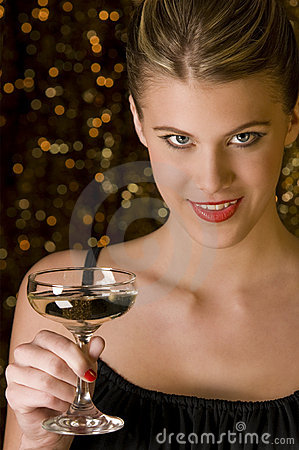 Attractive woman toasting with glass of champagne