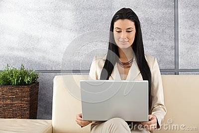 Attractive woman using laptop smiling