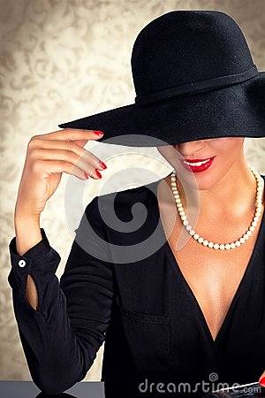 Attractive Woman Wearing Black Dress Hat And Pearls Stock