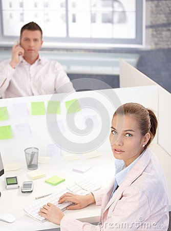 Attractive woman working on computer in office