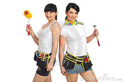 Attractive women holding construction tools