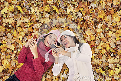 Attractive women over autumn foliage