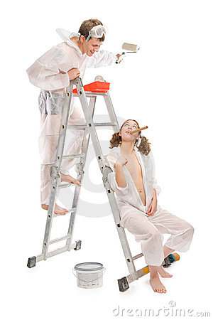 Attractive young adult couple painting