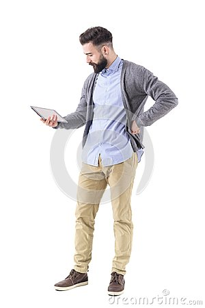 Free Attractive Young Bearded Modern Businessman Holding And Watching And Tablet Computer. Royalty Free Stock Images - 108116809