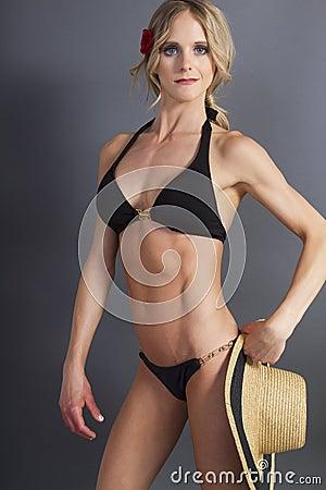 Attractive young blonde female in a bikini top