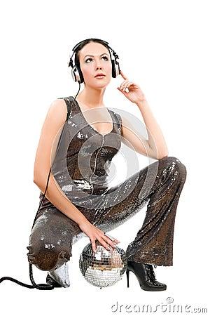 Attractive young brunette in headphones