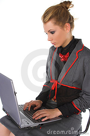 Attractive young business woman sitting on bar chair and working