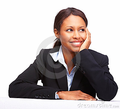 Attractive young business woman thinking